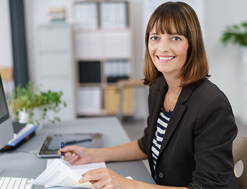 Woman working from home, sitting at desk