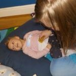 Marlow Opportunity Playgroup - Child on cushion