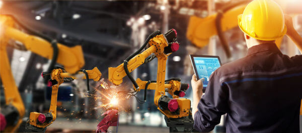 Man using ERP system on handheld in manufacturing plant